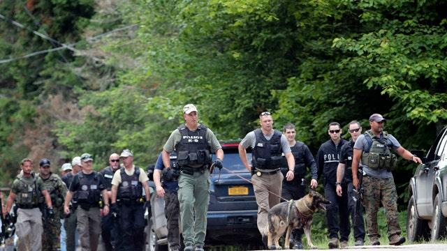 Search for escaped New York killers shifts to town near prison