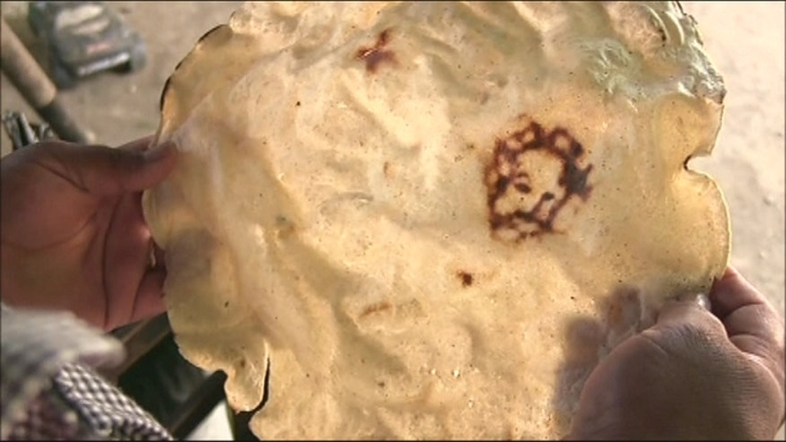 A woman from a small town in Mexico claims the image of Christ has appeared to her - in the form of a burn mark on a tortilla.