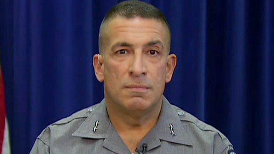 How did Sgt. Jay Cook and law enforcement officials take Sweat down after a marathon manhunt?