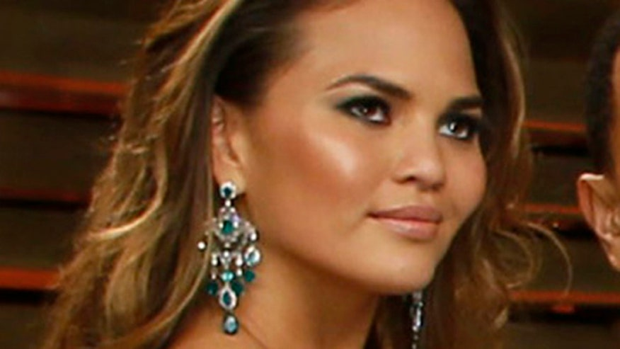 Teigen trying everything to get her topless pic on photo sharing site