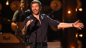 The country singer talks about his adventures, getting his fans involved, and his love for karaokee!