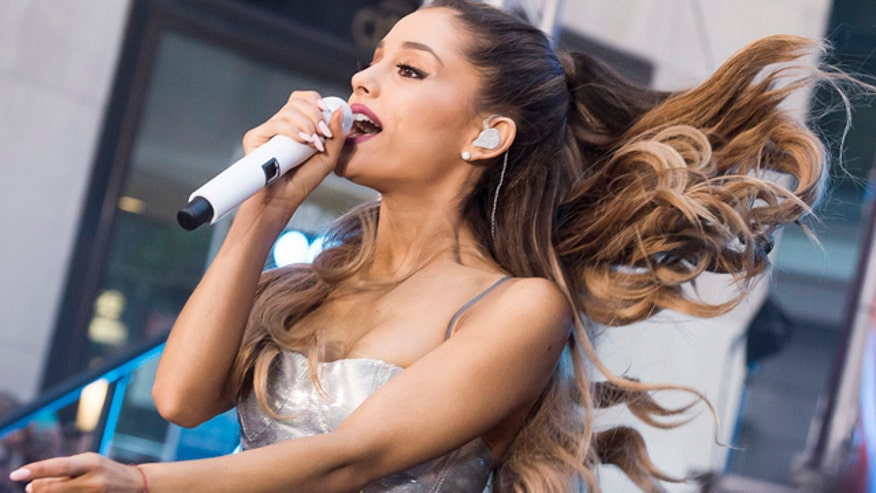 Police investigate Ariana Grande for doughnut licking