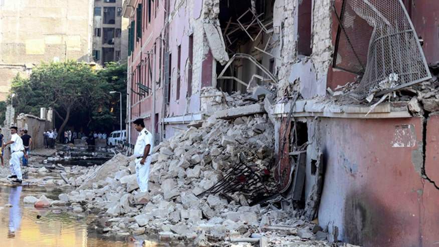 A car bomb outside the Italian Consulate in Cairo leaves one dead, nine injured