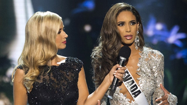 Miss Oklahoma wins Miss USA crown as Trump goes unmentioned