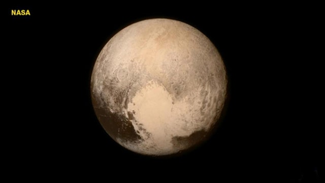 Spacecraft achieves flyby of Pluto, then calls home