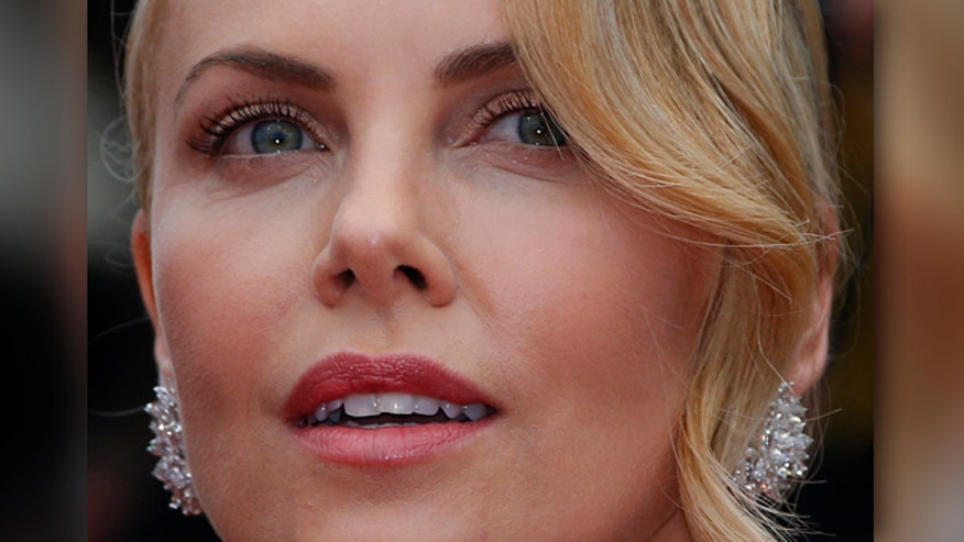 Charlize Theron mentioned strip club to Obama