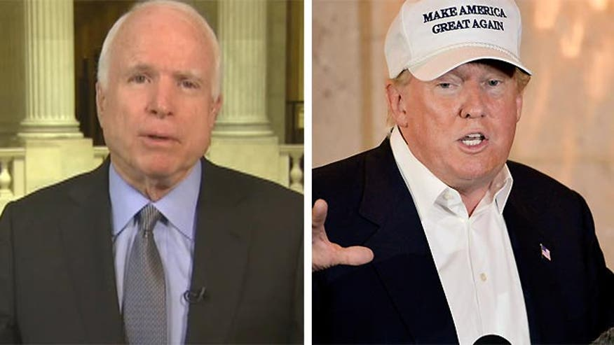 Senator John McCain reacts to the republican presidential contender's trip to Texas