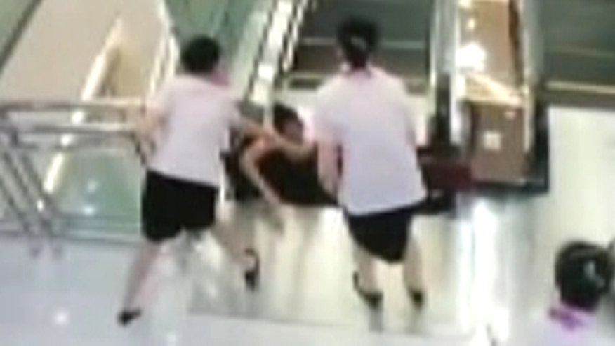 Raw video: 30-year-old woman falls into escalator moments after pushing boy to safety in China