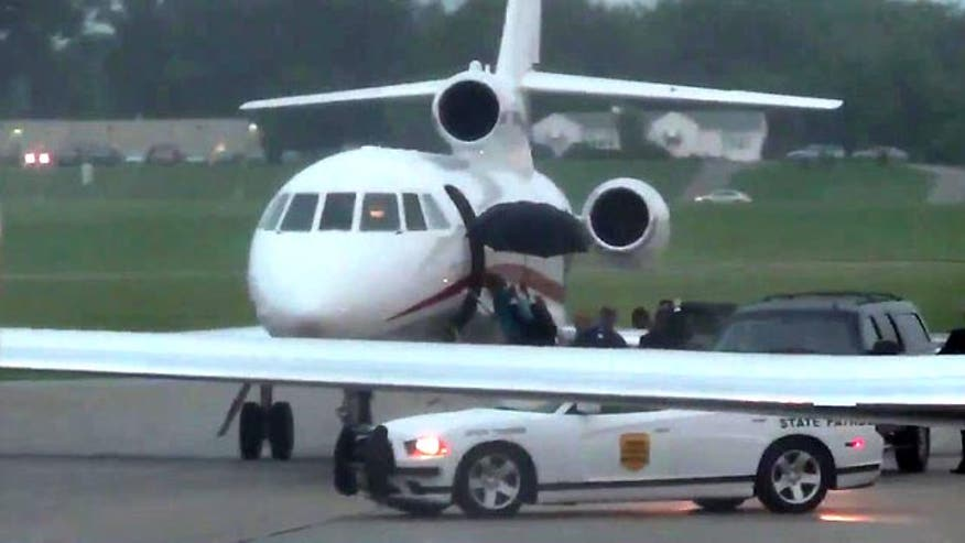 Presidential candidate boards private jet as she lays out climate change agenda