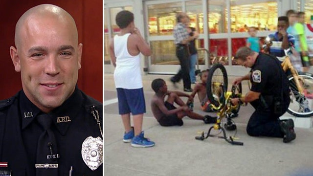 Photo of police officer fixing young boy's bike goes viral