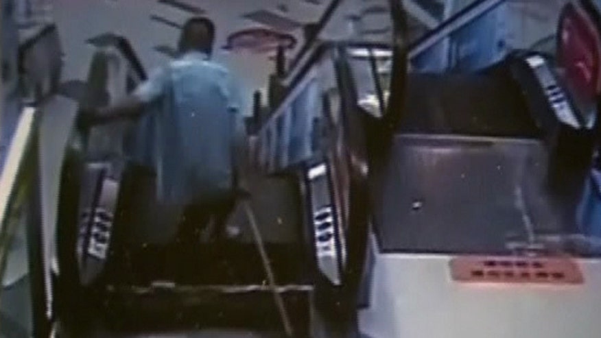 Security camera footage shows a cleaner's foot get caught, emergency crews freeing him