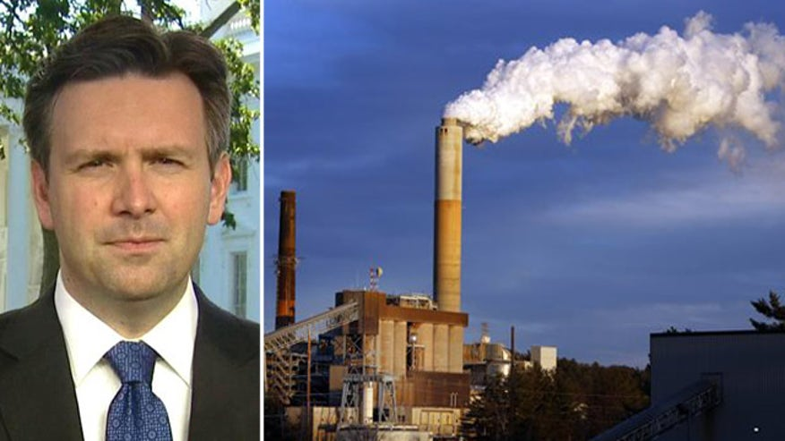 Press secretary Josh Earnest reacts to criticism of climate change agenda