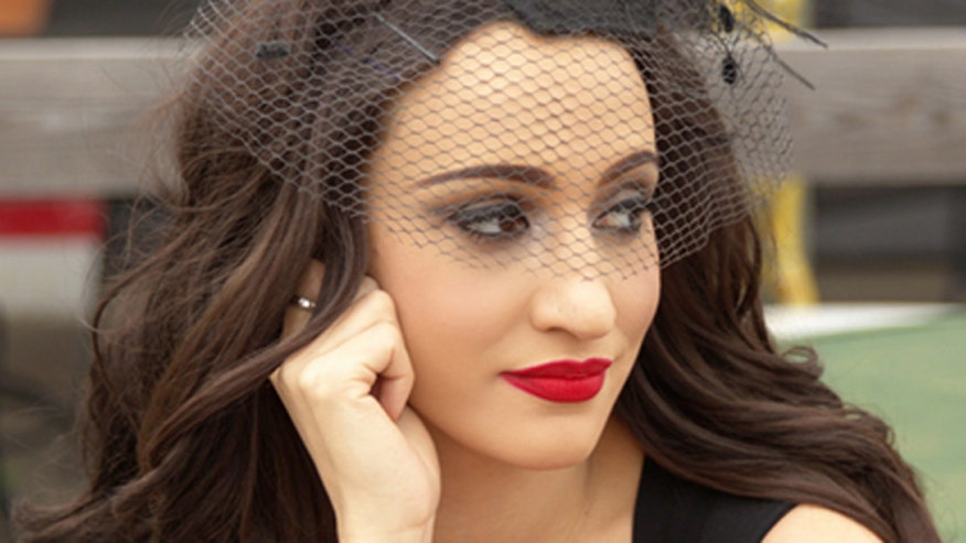 Country singer Lindi Ortega talks to FOX411 Country about her new album 'Faded Gloryville.'