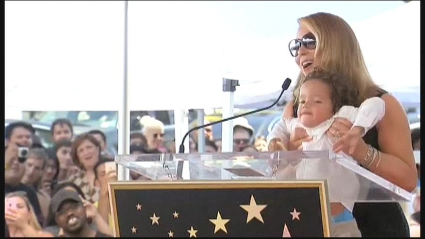 Mariah Carey received a star on the Hollywood Walk of Fame and while she was definitely the star of the show, her 4-year-old twins, Monroe and Moroccan Cannon, were not impressed. They wanted their mommy's attention and some time on the mic.