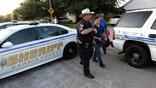 Gunman surrenders after shooting at police