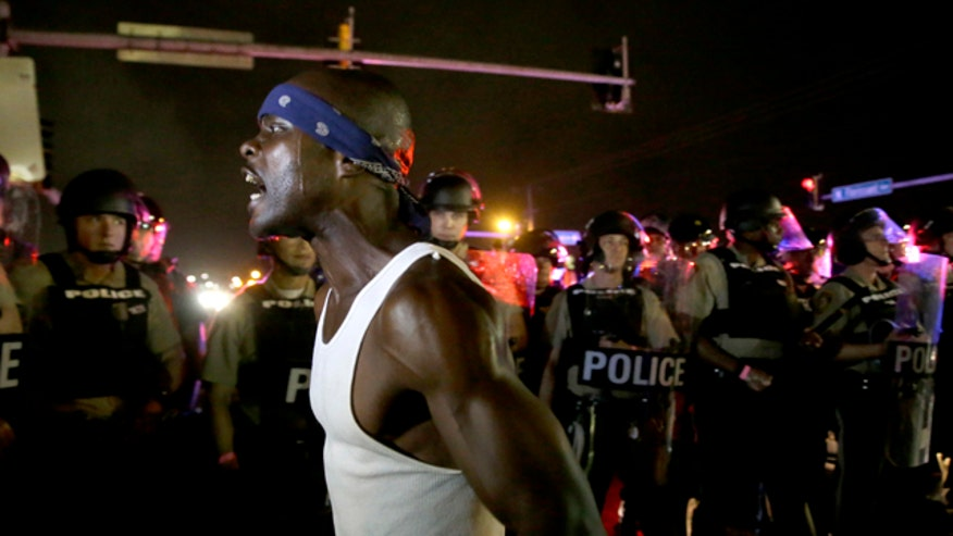 Gunfire erupts in Ferguson one year after Michael Brown's death