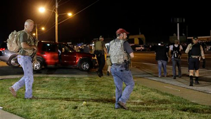 Gun toting militia group says they're protecting journalists, constitution