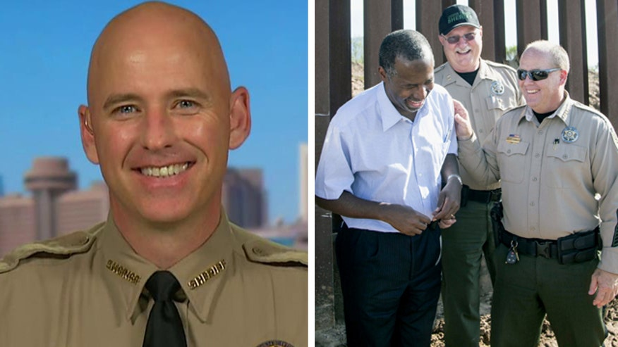 Sheriff Paul Babeu discusses the tour with the presidential candidate