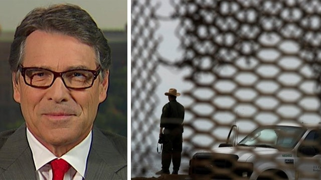 Perry says securing the border with a wall is 'not reality'
