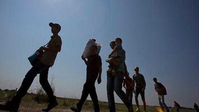 Hungary finishing border fence amid surge of migrants