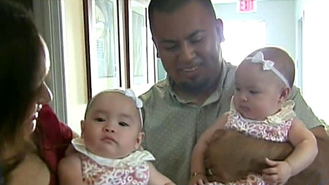 Magical moment deaf twin babies hear for first time