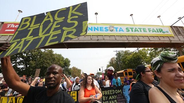 Black Lives Matter protesters taunt cops