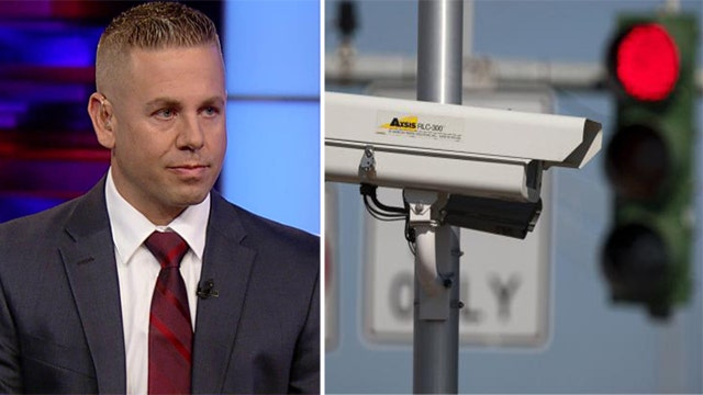 Man arrested for tampering with red light cameras speaks out
