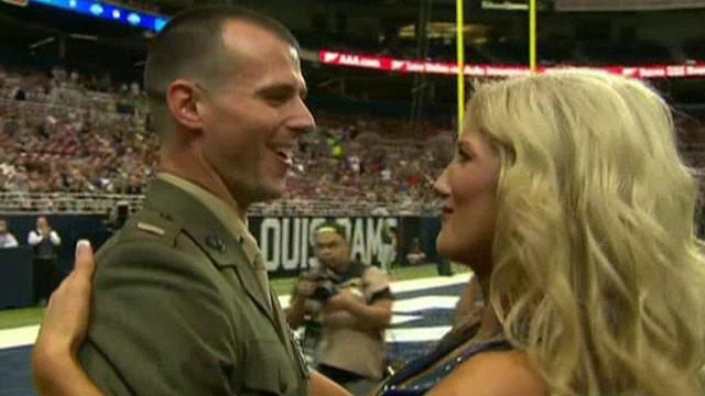 Rams cheerleader surprised by Marine husband