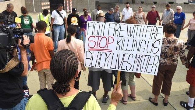 Black Lives Matter organizer defends defamatory chant
