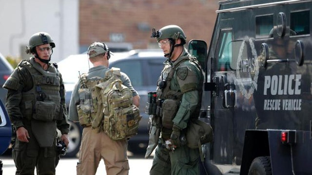 Manhunt for 3 armed suspects in shooting of police officer