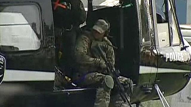 Manhunt underway after police officer shot in Illinois