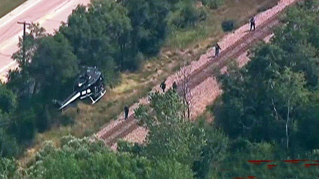 Cop killer suspects on the run north of Chicago