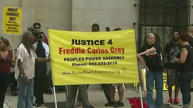 Baltimore braces for protests as Freddie Gray hearing begins