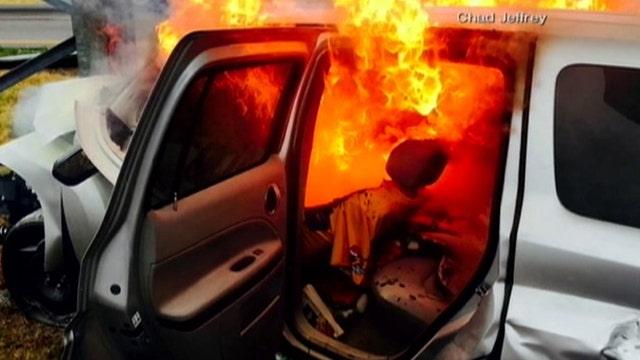Good Samaritans rescue woman from burning car