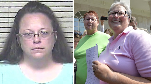 Jailed Kentucky clerk says issued marriage licenses to gay couples void