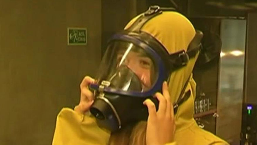 Gas masks, hazmat suits included