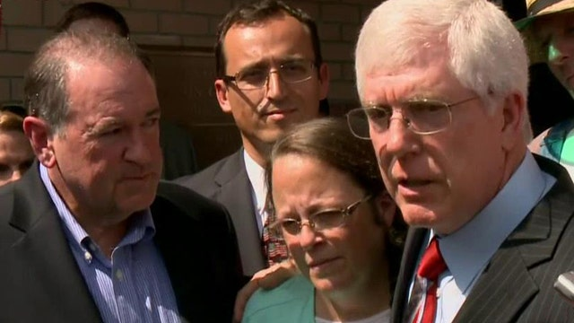 Kim Davis joined by attorney, Mike Huckabee at jail release