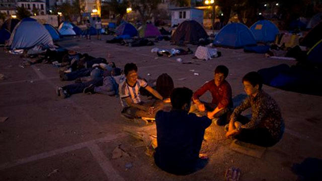 EU urges nations to agree to house 160,000 refugees