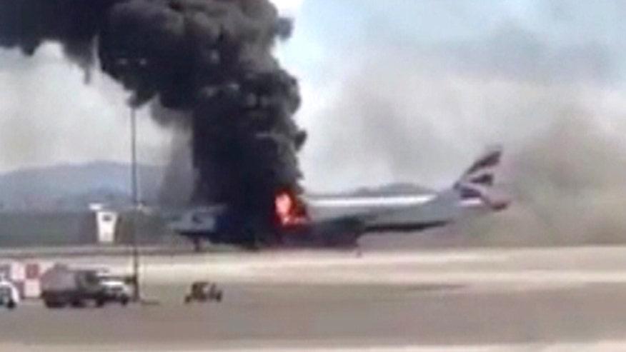 Raw video: Passengers escape blaze on London-bound plane