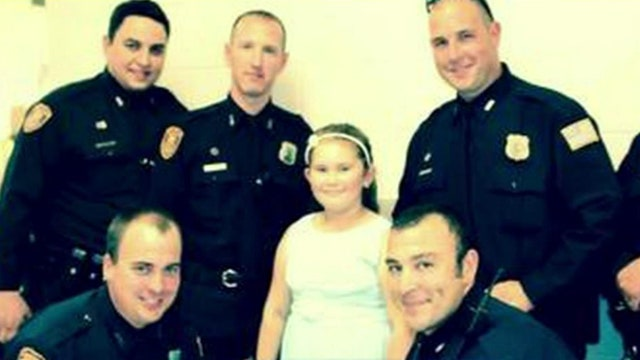 Cops escort child of fallen officer to father-daughter dance
