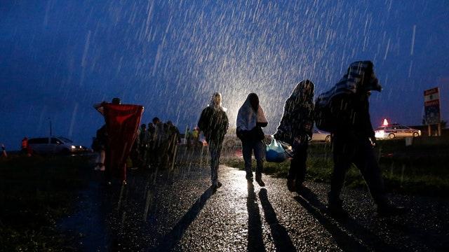 Thousands of refugees heading to Europe despite heavy rain
