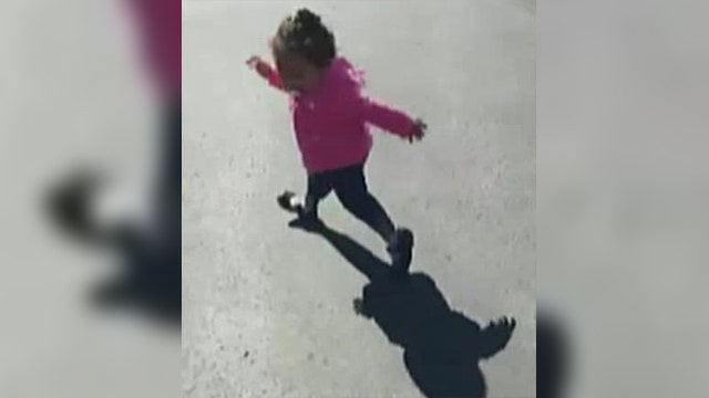 Little girl tries to run from her own shadow