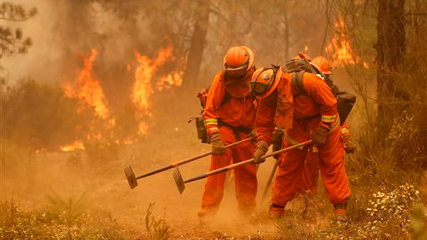 Firefighters battle huge wildfire in Northern California