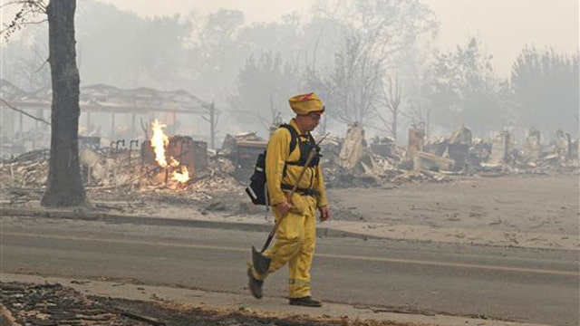 Fire Official: Wildfire has destroyed more than 100 homes