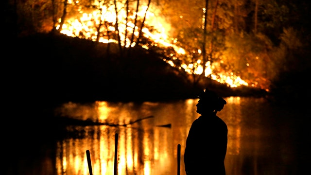 At least one dead, thousands flee homes from Calif. fires