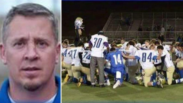 High school coach under investigation for prayer ritual