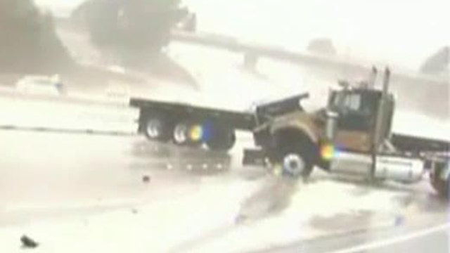 Out-of-control truck nearly crushes news crew on highway