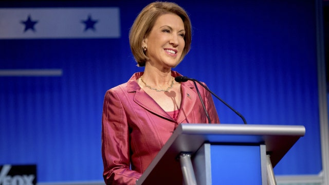 Fiorina's record questioned after strong debate performance