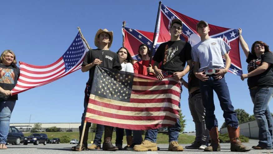 Group of teens from Christiansburg High School in Virginia proudly display fag after being told to leave school grounds when they refused to remove clothing