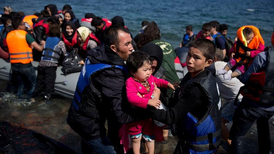 Refugees cross the Aegean Sea in flimsy, overcrowded boats